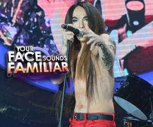 Kean Cipriano as Anthony Kiedis of Red Hot Chili Peppers -